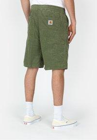 Carhartt WIP - Shorts - mottled dark green - 1