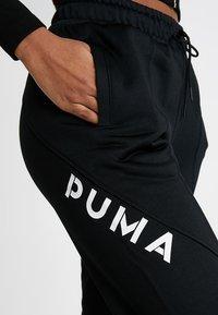 Puma - TRACK PANT - Tracksuit bottoms - puma black - 3
