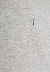 YOURTURN - LOOSE FIT JOGGERS UNISEX - Tracksuit bottoms - mottled light grey - 2