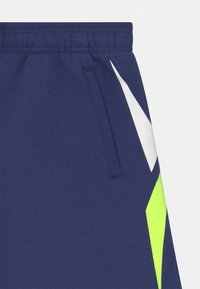 Reebok - VECTOR PLACEMENT - Tracksuit bottoms - navy - 2