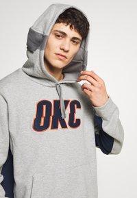 Nike Performance - NBA COURTSIDE HOODY THUNDER EARNED - Club wear - dark grey heather/college navy - 4
