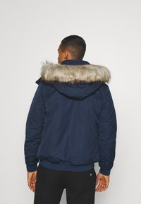 Tommy Jeans - TECH BOMBER UNISEX - Winter jacket - twilight navy - 2