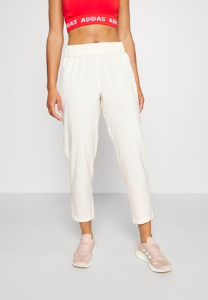 BRANDED PANT - Tracksuit bottoms - white