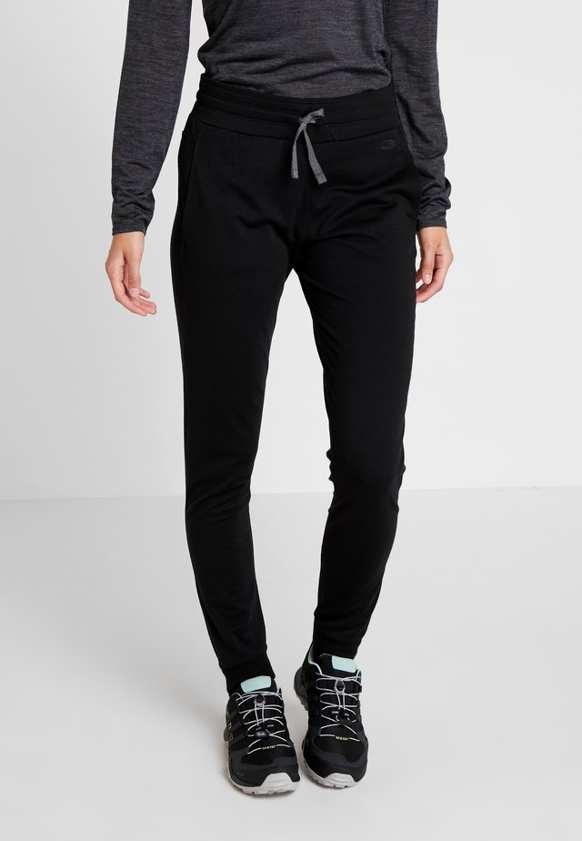 CRUSH PANTS - Trainingsbroek - black