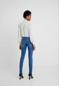 Kings Of Indigo - JUNO - Slim fit jeans - veggie warp mid stone - 2