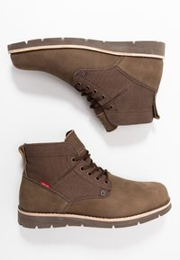 Levi's® - JAX - Lace-up ankle boots - dark brown - 1