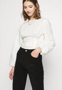 Topshop - JAMIE - Flared Jeans - black - 3