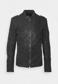 Tigha - STIGO - Leather jacket - black stone wash - 0
