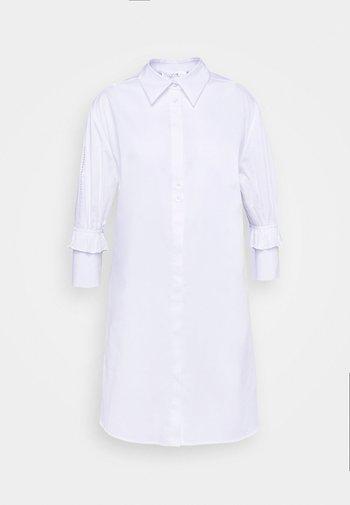 RUFFLE CUFF DRESS