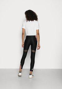 Desigual - CALIX BY CHRISTIAN LAXROIE - Leggings - Trousers - black - 2