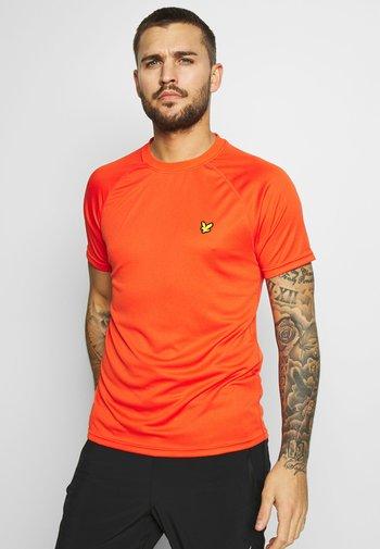 CORE RAGLAN - T-shirt - bas - amber blaze