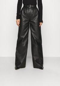 Deadwood - PINE PANTS - Leather trousers - black - 0