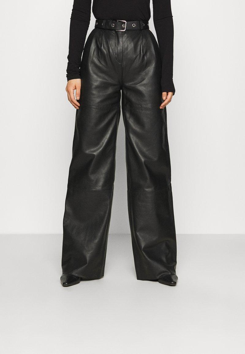 Deadwood - PINE PANTS - Leather trousers - black
