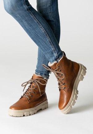 Lace-up ankle boots - cognac braun