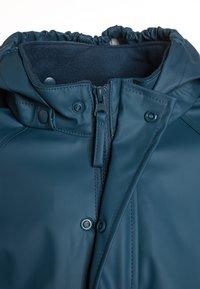 CeLaVi - RAINWEAR SUIT BASIC SET WITH FLEECE LINING - Rain trousers - iceblue - 5