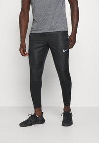 Nike Performance - Teplákové kalhoty - black/reflective silver - 0