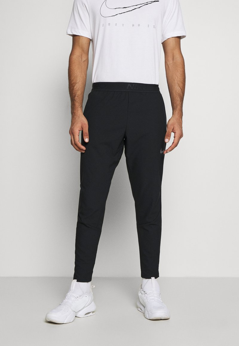 Nike Performance - VENT MAX PANT - Tracksuit bottoms - black/dark grey