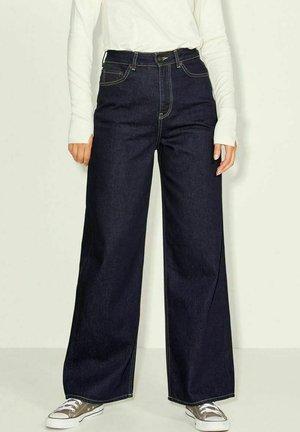 TOKYO - Flared Jeans - dark blue denim