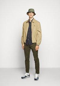 Polo Ralph Lauren - STRETCH SLIM FIT COTTON CHINO - Pantalon classique - expedition olive - 1