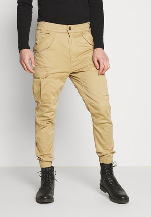 AIRMAN - Cargo trousers - sand