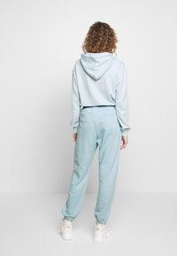 Missguided - OVERSIZED JOGGER - Tracksuit bottoms - blue - 2