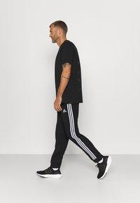 adidas Performance - Pantalon de survêtement - black - 3