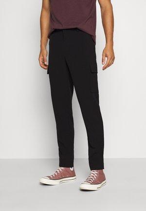 CLUB PANTS - Pantaloni cargo - black