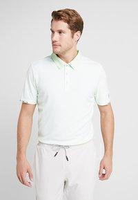 adidas Golf - CLIMACHILL TONAL STRIPE - Sports shirt - glow green/white - 0