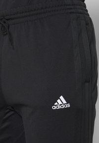 adidas Performance - PANT - Tracksuit bottoms - black - 4