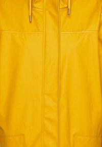 Helly Hansen - MOSS RAIN COAT - Waterproof jacket - essential yellow - 2