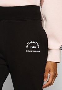 KARL LAGERFELD - ADDRESS LOGO PANTS - Tracksuit bottoms - black - 5