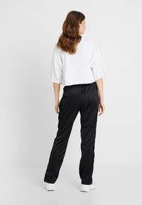Fila Tall - GERALYN TRACK PANTS - Tracksuit bottoms - black - 2