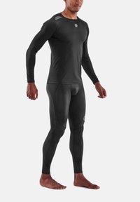 Skins - Sports shirt - black - 1