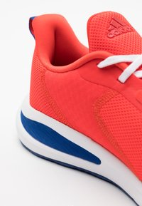 adidas Performance - FORTARUN KIDS NEXT CLOUDFOAM TRAINING SHOES UNISEX - Neutral running shoes - vivid red/footwear white/collegiate royal - 5