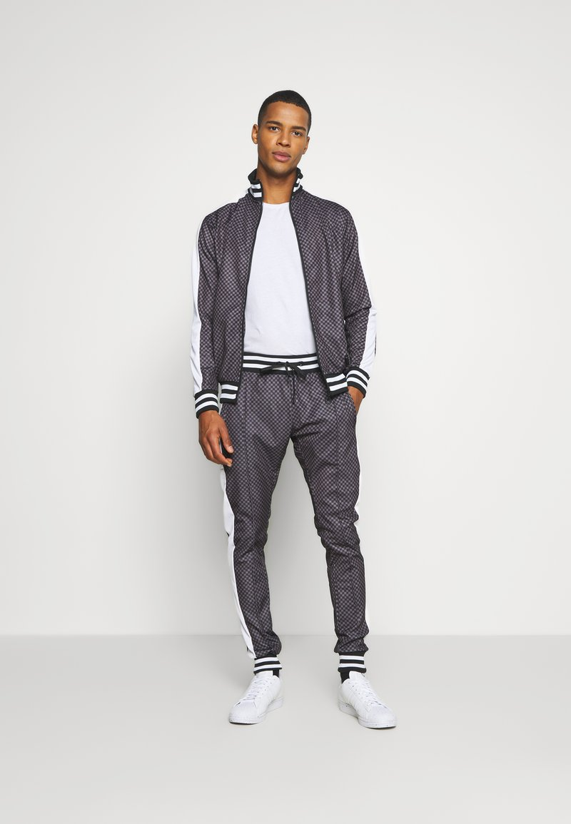 Night Addict - Tracksuit bottoms - grey/black