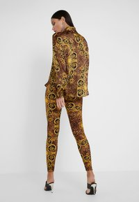 Versace Jeans Couture - Leggings - Trousers - gold - 2