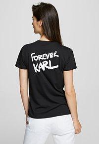 KARL LAGERFELD - FOREVER KARL - Print T-shirt - black - 2