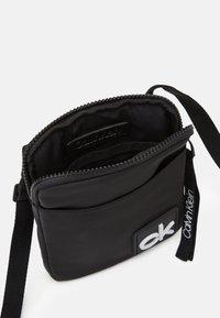 Calvin Klein - FLAT PACK  - Across body bag - black - 2