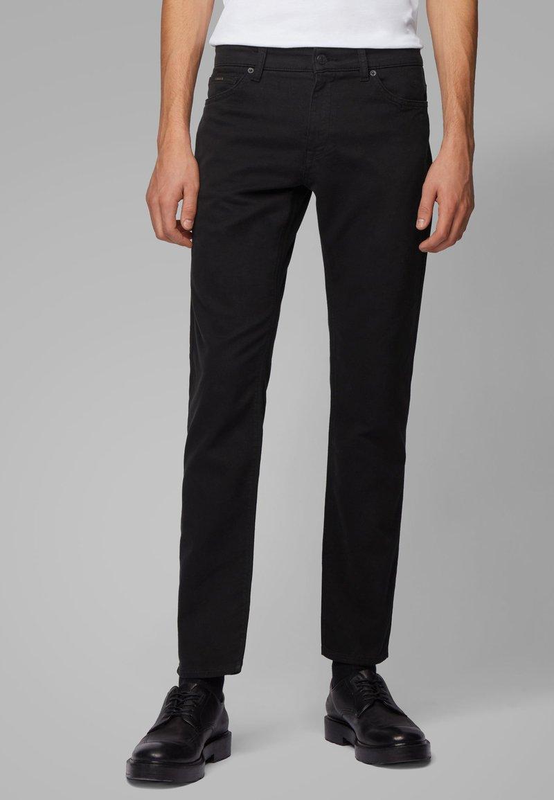 BOSS - MAINE - Straight leg jeans - black