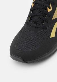 Reebok - RUNNER 4.0 - Neutral running shoes - black/gold metallic - 5