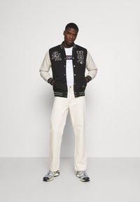 Hollister Co. - TREND DROP VARSITY - Zip-up sweatshirt - black - 1