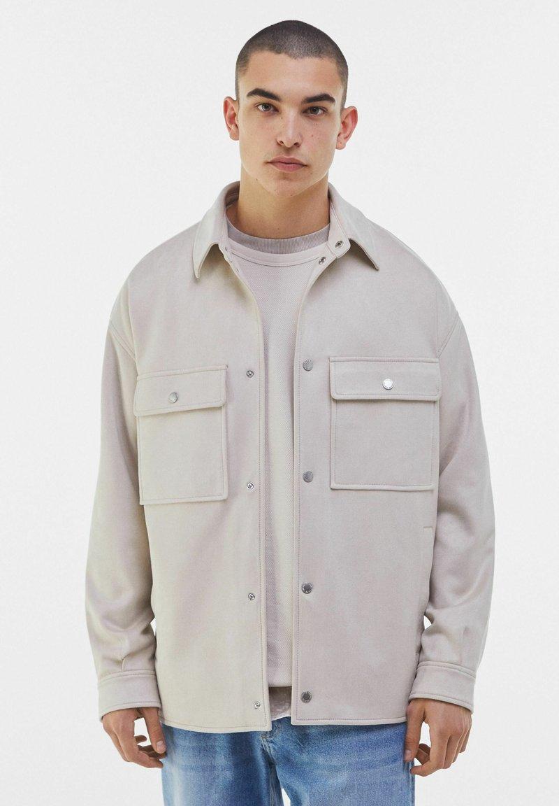 Bershka - Faux leather jacket - stone