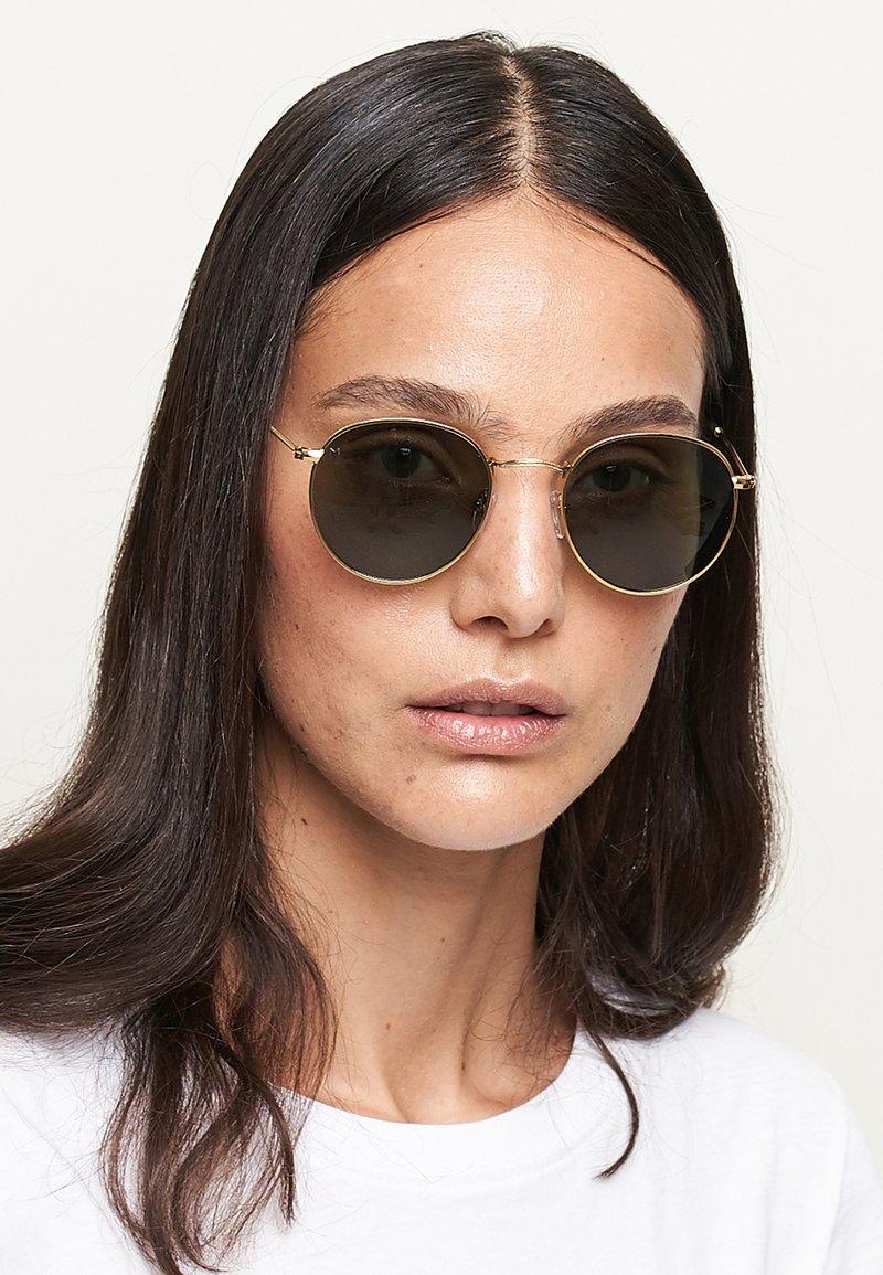 Meller - Sunglasses - gold olive