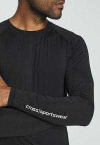 Cross Sportswear - ARMOUR - Koszulka sportowa - black - 3