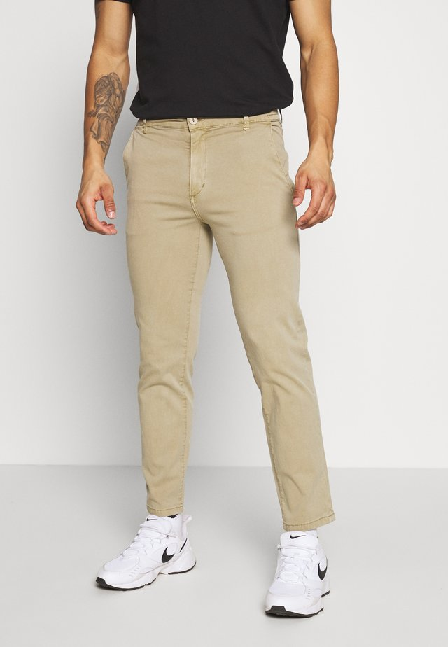 ELASTICATED WASHED PANTS - Chinos - light khaki