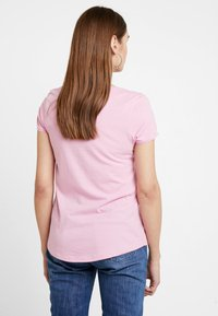 Tommy Jeans - SOFT V NECK TEE - Basic T-shirt - pink