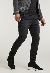 CHASIN' - RESA.L THOR - Trousers - black - 0