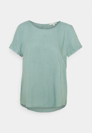 FEMININE WITH ZIPPER - Print T-shirt - mineral stone blue