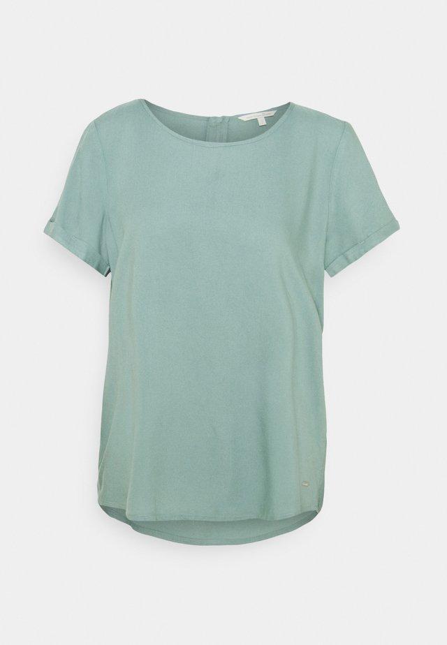 FEMININE WITH ZIPPER - Camiseta estampada - mineral stone blue