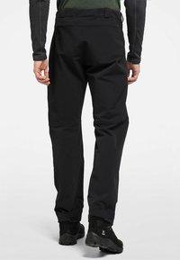 Haglöfs - BRECCIA PANT - Outdoor trousers - true black/magnetite short - 1